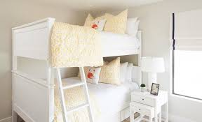 girls white bedside table white bunk beds with white nesting end table cottage s room