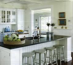 cottage kitchen islands beadboard backsplash white kitchen island with butcher block