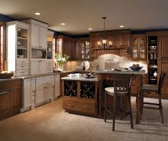 kitchen island colors with wood cabinets cherry wood cabinets with two level kitchen island masterbrand