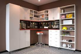 masculine garage organization solutions roselawnlutheran garage space is maximized through the use of basic white tall melamine cabinets and a combination