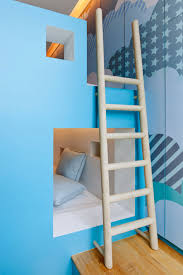 loft bed among white ladder also white mattress under home bedroom
