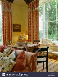 pink colefax fowler curtains at tall windows in country living