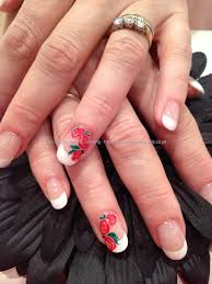 pink and white acrylic overlays with red rose freehand nail art
