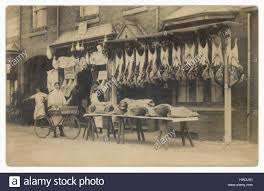 butcher shop black and white stock photos butcher shop black and edwardian postcard of butcher s shop displays displaying meat hanging outside with men staff