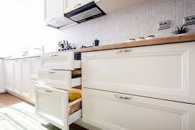 is it cheaper to replace or reface kitchen cabinets what s the cost to reface kitchen cabinets cabinet coatings