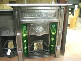 floor to ceiling tiled fireplace fully polished cast iron surround