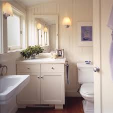 beachy bathroom design with white beadboard bathroom cabinets