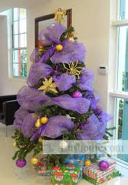tree decorating with colorful ribbons
