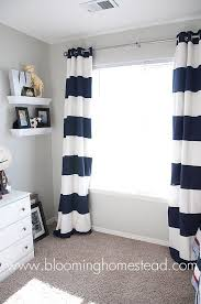 stylish white curtains with navy trim and navy and cream trellis
