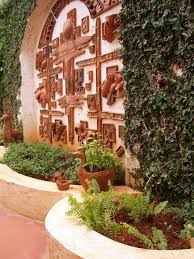 backyard with climbing plants and mediterranean wall arts