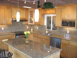 what color countertops go with maple cabinets natural maple cabinets with granite countertops