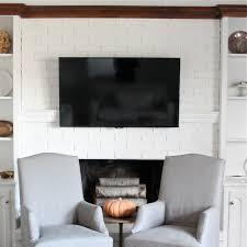 interior white brick wall mounted mantel shelf with dark brown