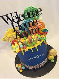 boys yellow drip birthday cake made by sweetsbysuzie