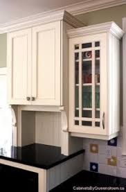 how to install kitchen wall cabinets with crown molding crown mouldings on varying cabinet heights stonehaven