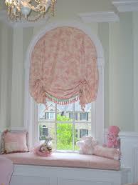 pleated balloon shade on arched window terri mann flickr