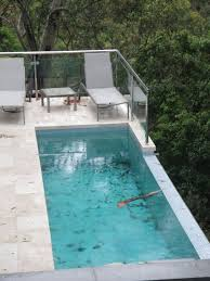 above ground lap pool decofurnish rooftop lap pool with view and glass railing also great furniture