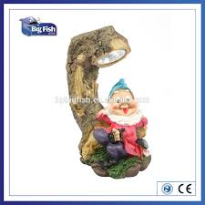 solar powered polyresin garden gnome on tree stump spot camping