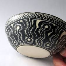 hand crafted handmade stoneware bowl with hand carved ammonite