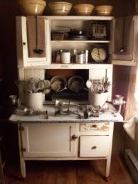 hoosier cabinet with great collection of yellow ware and vintage