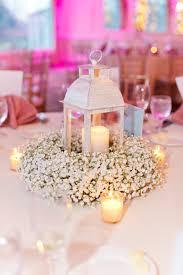 white lantern centerpieces white lanterns with and baby s breath pam dans wedding