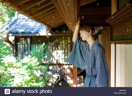 caucasian man wearing yukata in traditional japanese house stock