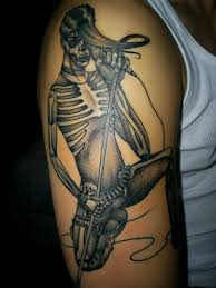 skeleton with mic tattoo on arm photos pictures and sketches