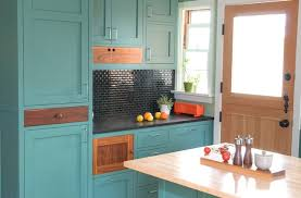 painted kitchen cabinets with stained doors kitchen cabinet color should you paint or stain