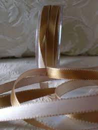ivory satin ribbon sided stitched satin ribbon gold ivory 7 16 width 55 yds 3 260 jpg