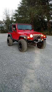 white jeep stuck in mud mudclaw wrangler m t tire j107078 available from 31 in to 35 in