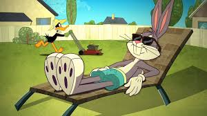 image bugs sunbathes and daffy mowing the lawn in the backyard