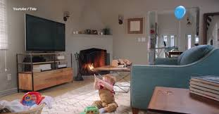 new tide advert asks parents to spot dangers to child in a room