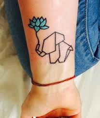 my first tattoo origami elephant with blue lotus flower