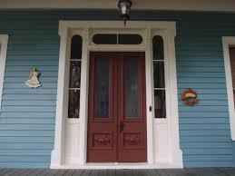 Double Glass Door by Interior Double Glass Door With Brown Wooden Frame Having Carving