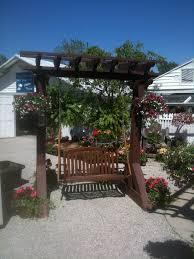 swing pergola great outdoor patio with paved floor and white stained chairs also