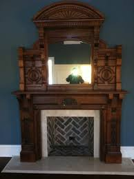 hand carved surround mirror above fireplace marble hearth