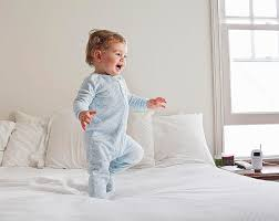 Baby Sleeper In Bed How To Choose A Bedside Sleeper Or Cosleeping Bassinet
