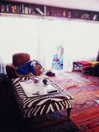 bohemian living room idea with zebra coffee table and full print