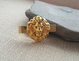 urban lion ring holder images Handmade oxidized gold lion tie clip urban metal designs jpg