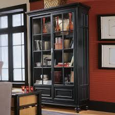 free standing black wooden bookcase with four shelves also glass