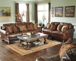 ashley leather sofa set ashley genuine top grain leather brown sofa loveseat chair and a