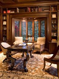 traditional home office design with arm chairs and wooden desk and