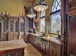 gothic kitchen with ornate hood over gas range designing a