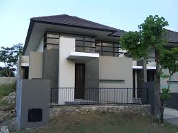 contemporary split levels exterior house design with grass green