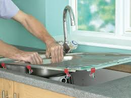 how to install a kitchen sink faucet how to install a kitchen sink in a laminate or wood countertop