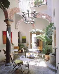 spanish courtyard design with metal furniture and chandelier