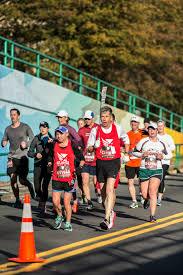 thanksgiving atlanta half marathon pace leads atlanta track club