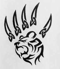planning on getting this tiger tribal tattoo with one colored