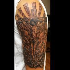 jesus tattoo cross tattoo flower tattoos half sleeve tattoo idea