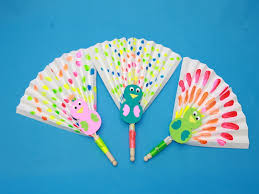 paper fans cool this summer with diy peacock paper fans