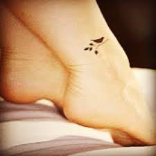 black ink small sparrow tattoo on ankle tattooshunt com